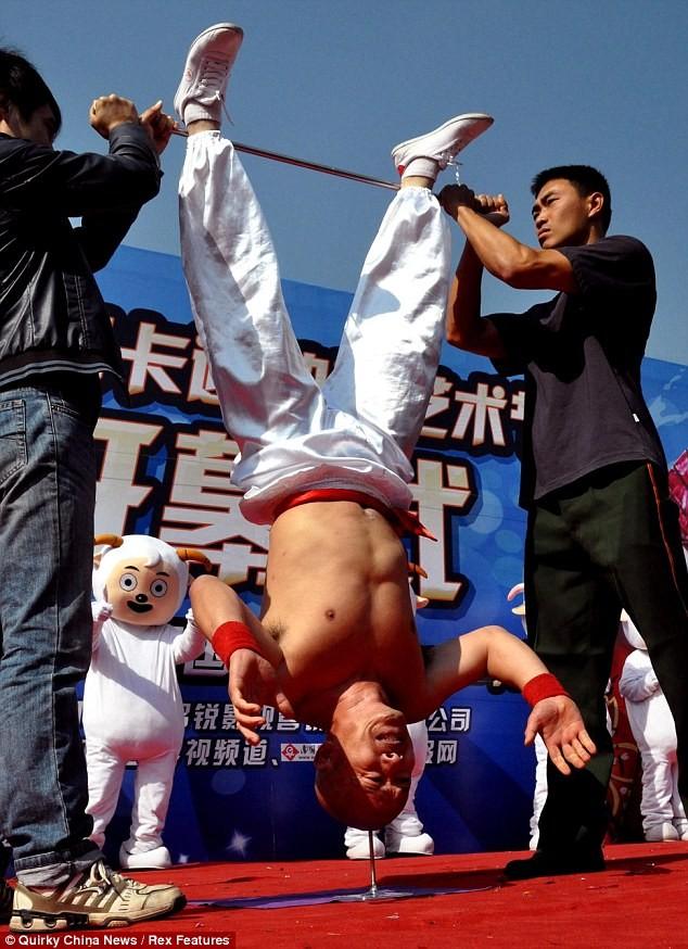 headstand nail chinese man